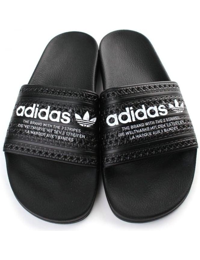 buy online 9ac49 8a2d2 Adilette Men  039 s Logo Sliders Black